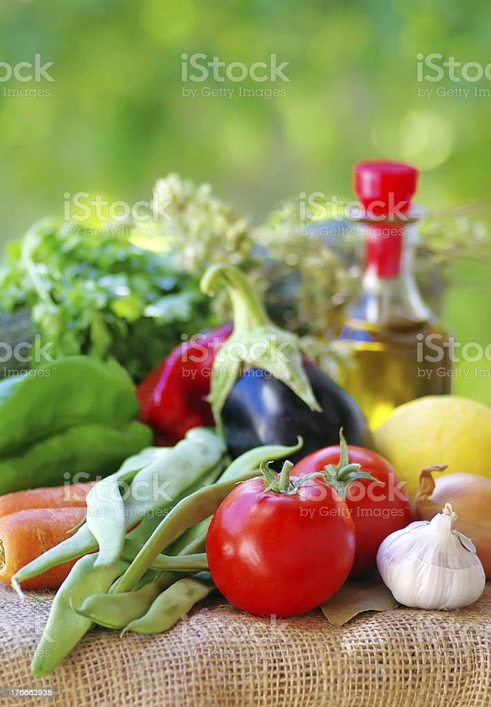Fresh vegetables , olive oil and spices royalty-free stock photo