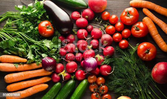 507328769 istock photo fresh vegetables on a wooden background 859097658
