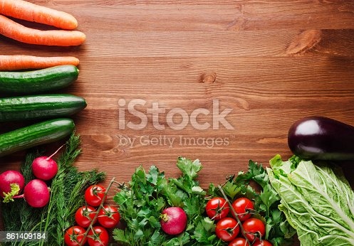507328769 istock photo fresh vegetables on a wooden background 861409184