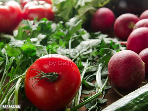 507328769 istock photo fresh vegetables on a wooden background 867863268
