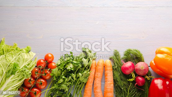 507328769 istock photo fresh vegetables on a wooden background 867863270