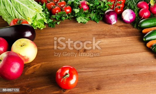 507328769 istock photo fresh vegetables on a wooden background 884867120