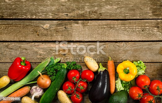 istock Fresh vegetables on a wooden table 607299466