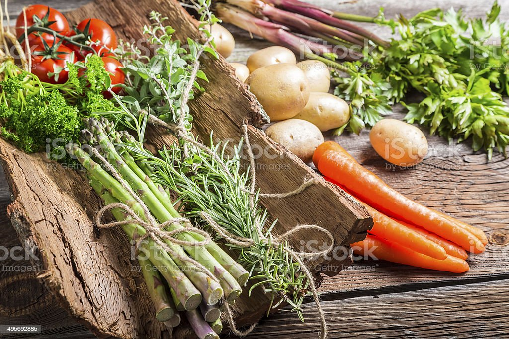 Fresh vegetables on bark stock photo