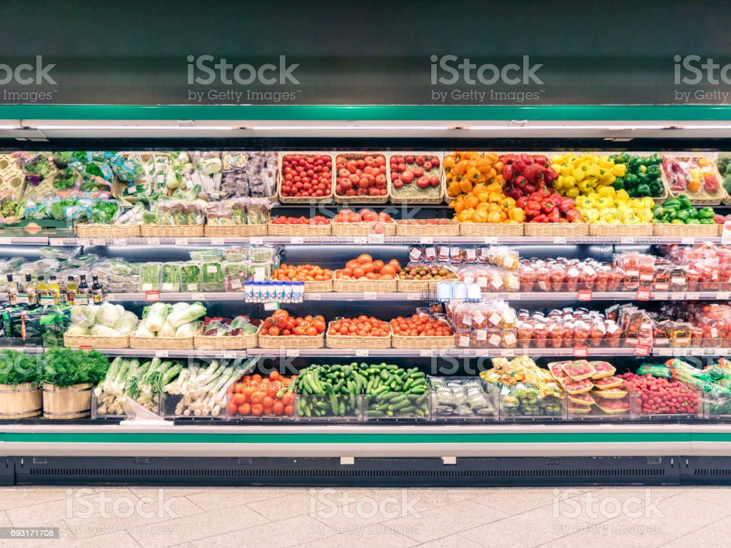 Fresh vegetables on shelf in supermarket stock photo