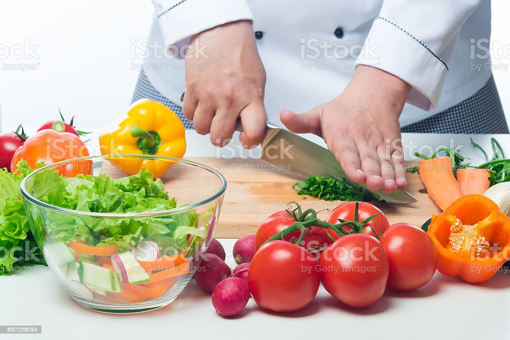 fresh vegetables on the table the cook prepares salad stock photo