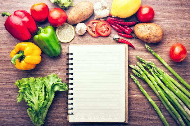Fresh vegetables on the wooden background and paper for notes stock photo