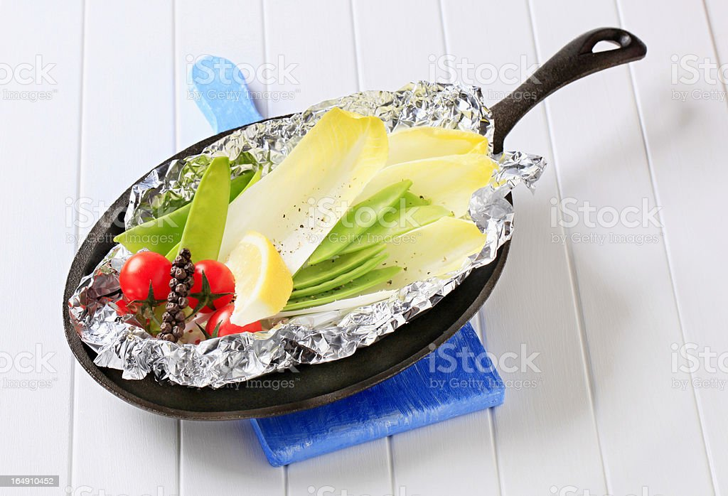 Fresh vegetables on tinfoil in skillet royalty-free stock photo