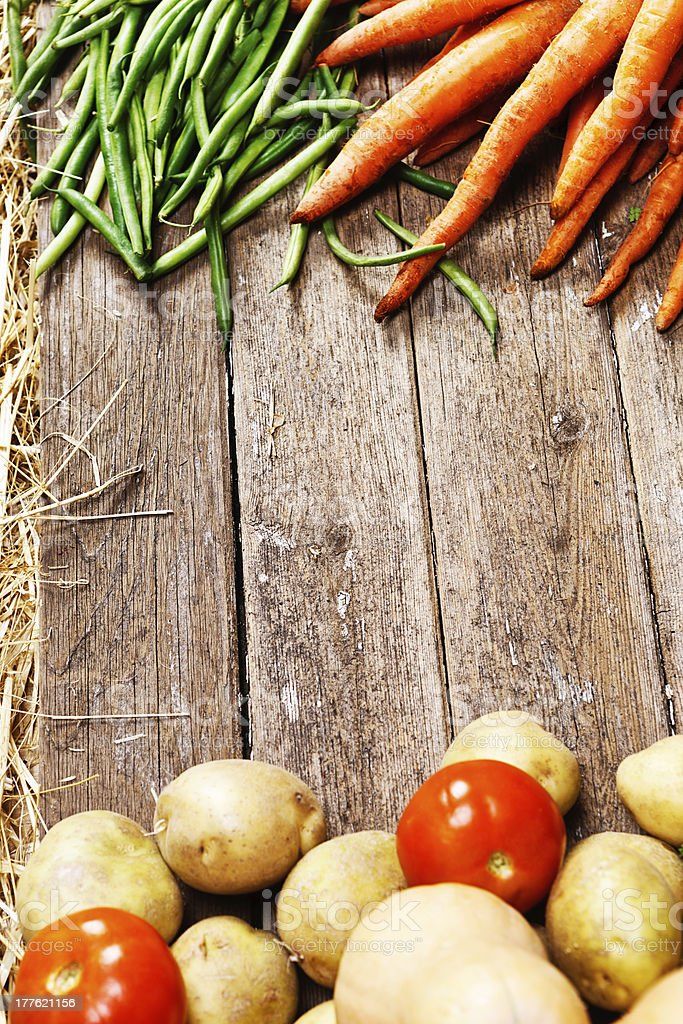Fresh vegetables on weathered wooden copy space royalty-free stock photo