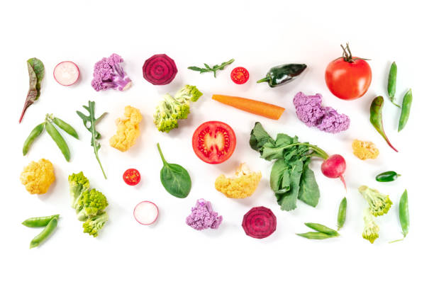 Fresh vegetables overhead flat lay composition on a white background stock photo
