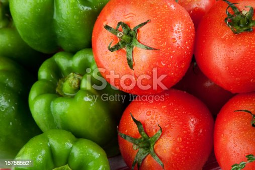 Fresh tomatoes and green bell peppers.