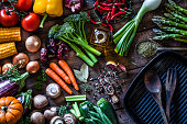 istock Fresh vegetables ready for cooking shot on rustic wooden table 882314790