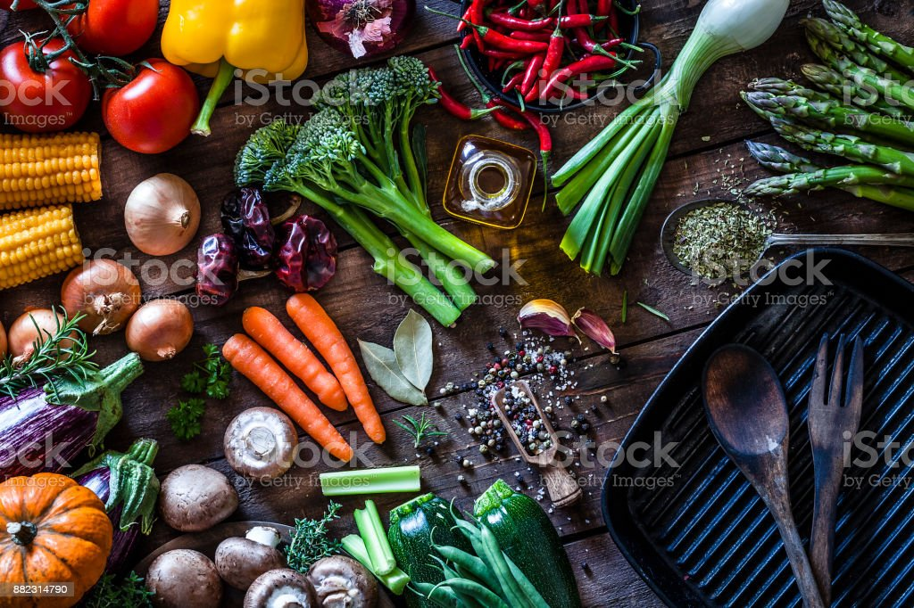 Fresh vegetables ready for cooking shot on rustic wooden table stock photo