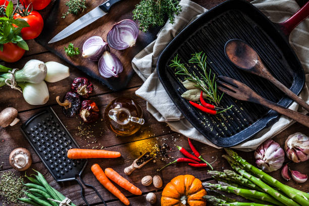 Fresh vegetables ready for cooking shot on rustic wooden table - foto stock