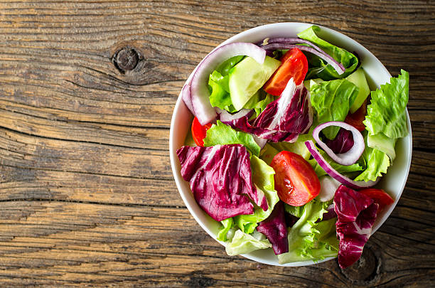 fresh vegetables salad on wooden table - lettuce stock photos and pictures