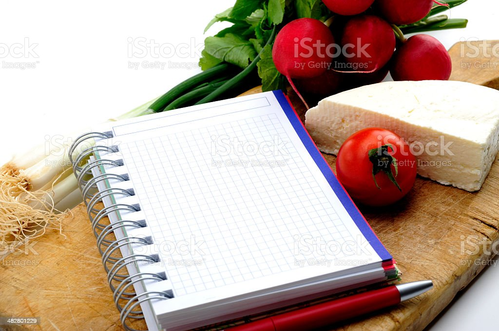 Fresh vegetables with cheese and blank recipe book stock photo