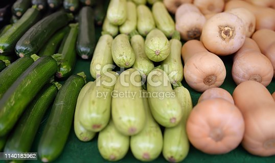 istock Fresh vegetables - zucchini, squash and pumpkin on farmer agricultural market 1140183962