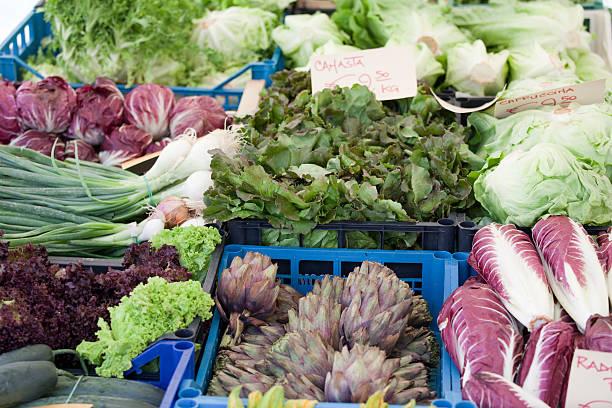 Fresh vegetarian greens at open street vegetable market stock photo