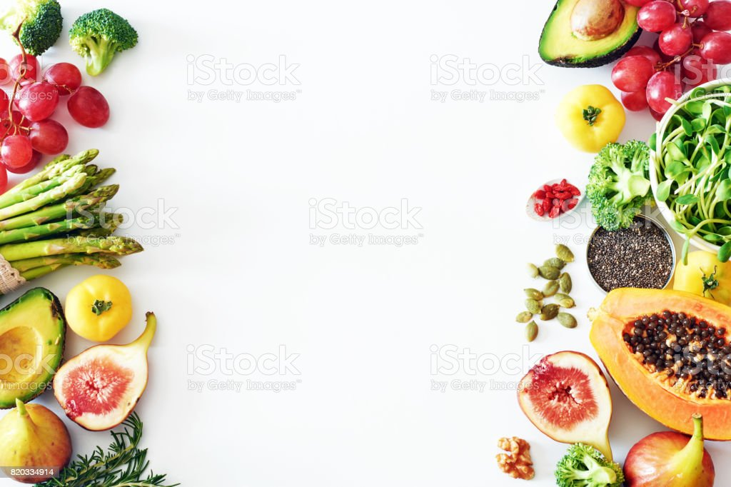 Fresh veggies and fruits food frame on white background with copy space. stock photo