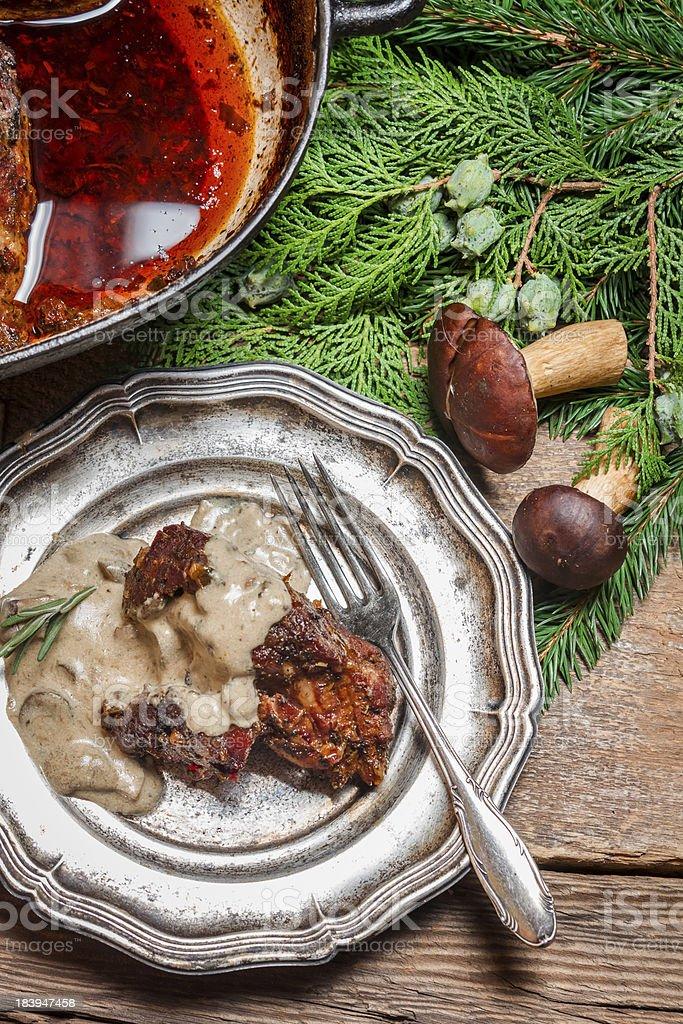 Fresh venison served with wild mushroom sauce stock photo