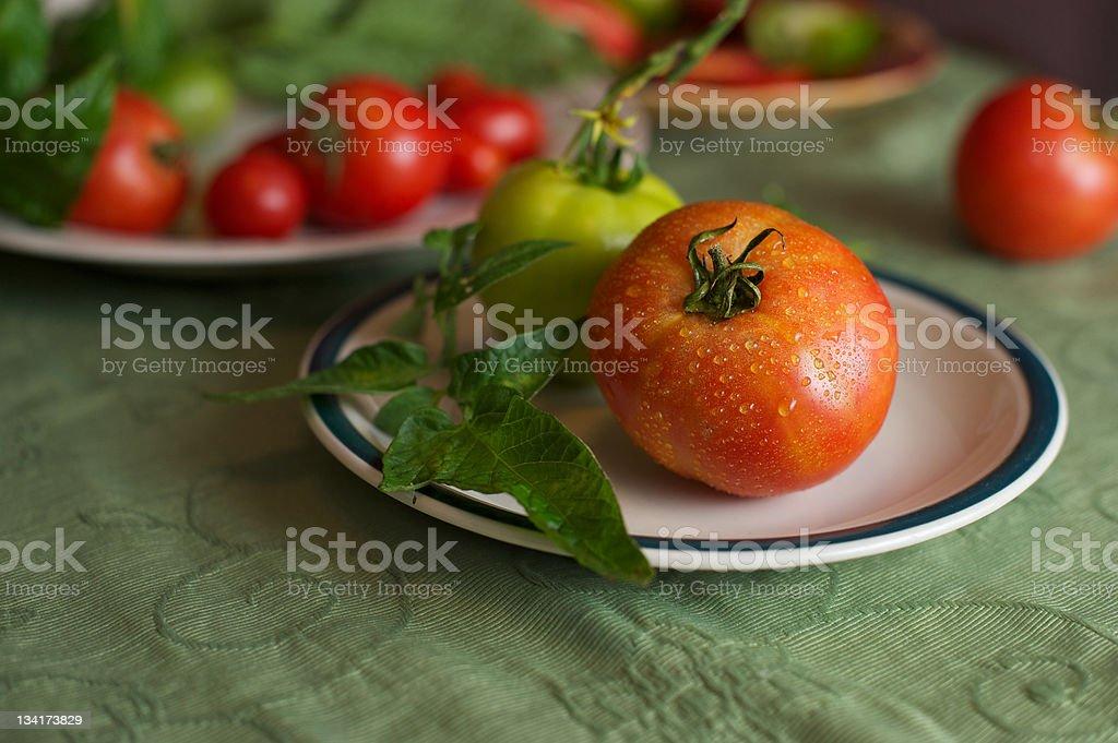 Fresh Vibrant Orange-Red Tomato with other Produce stock photo