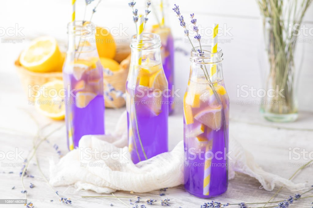 Fresh violet cocktail with lemon, ice and lavender stock photo