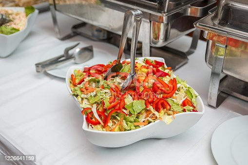 Fresh vitamin salad with red peppers, cabbage, carrots, served on the restaurant buffet table.