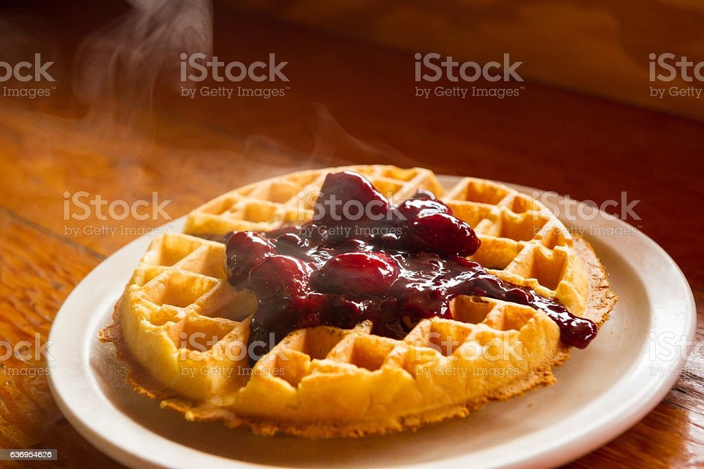 Fresh waffles with berry compote stock photo