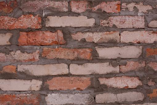 Fresh wall of red brick