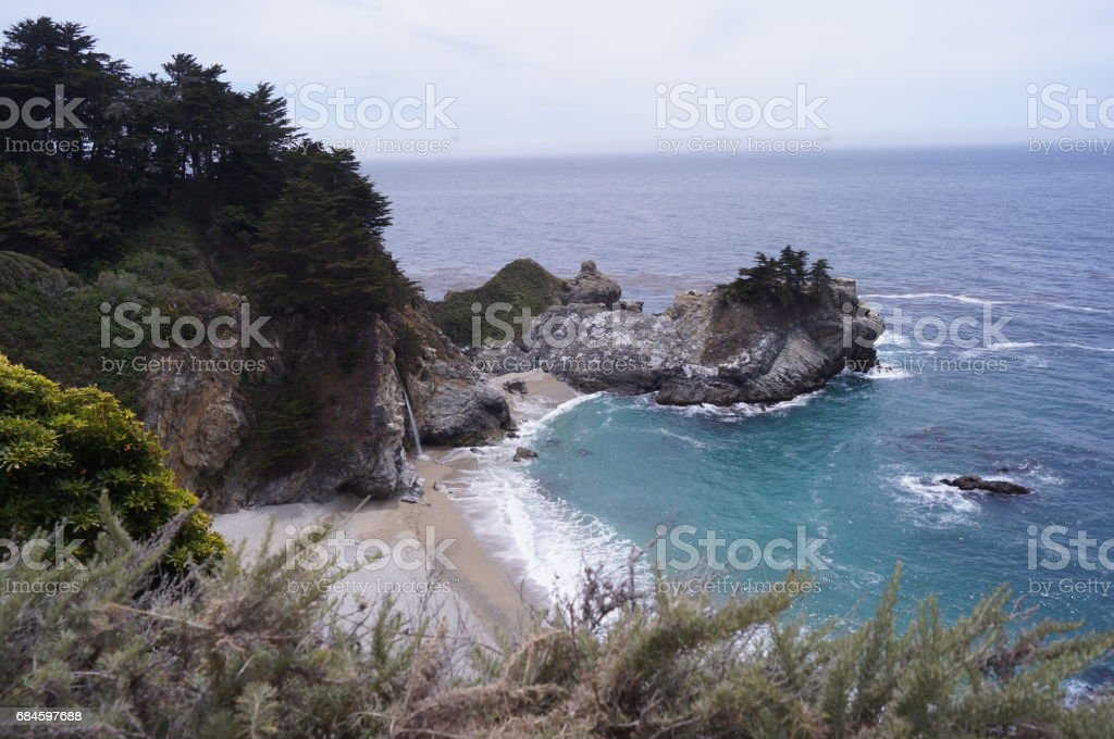 Fresh water falls directly to the sea. stock photo