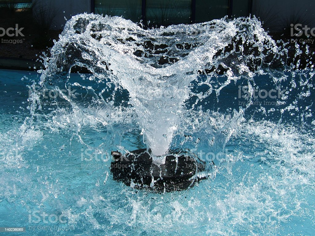 A fresh water fountain spraying water into the air royalty-free stock photo