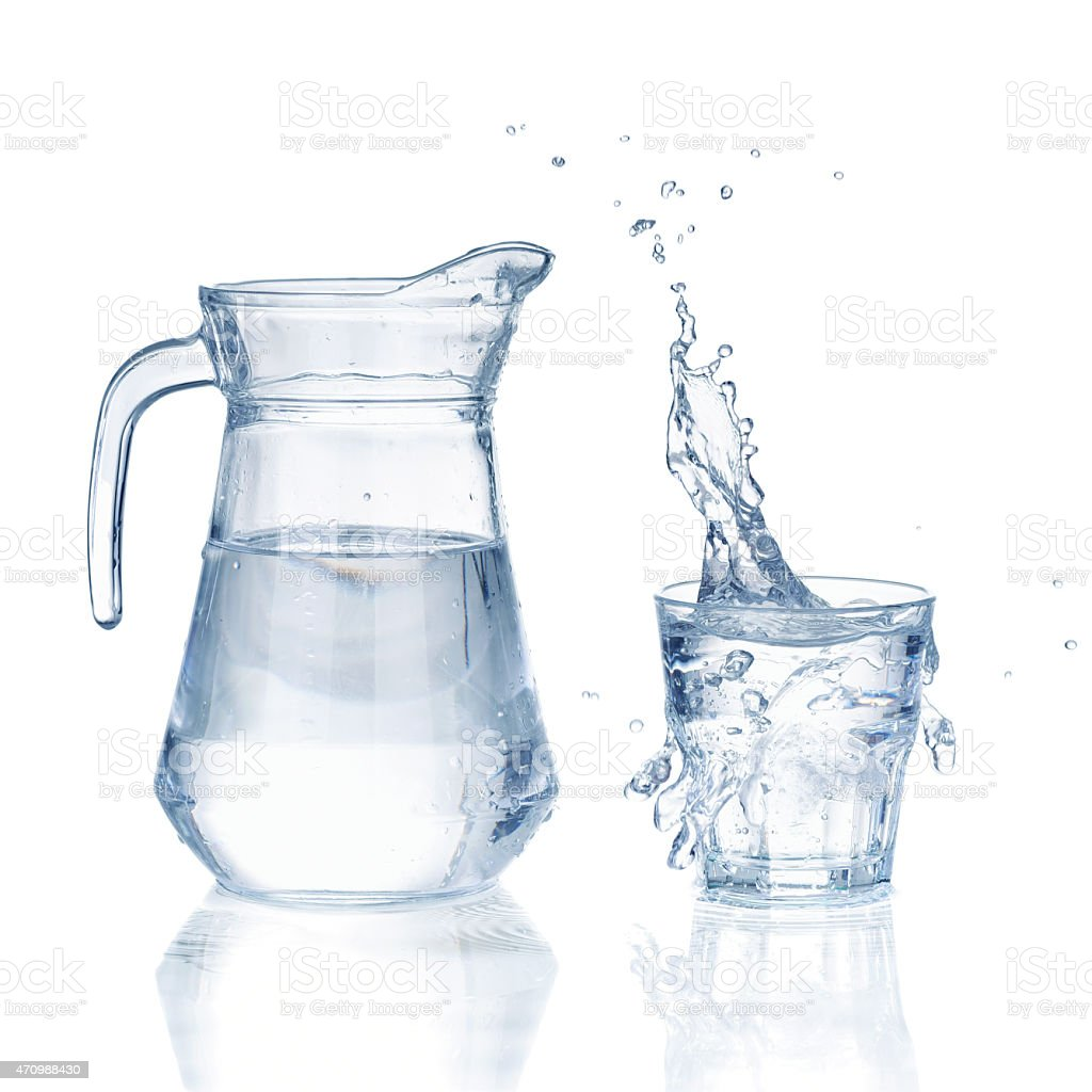 Fresh water glass with splash and bottle stock photo