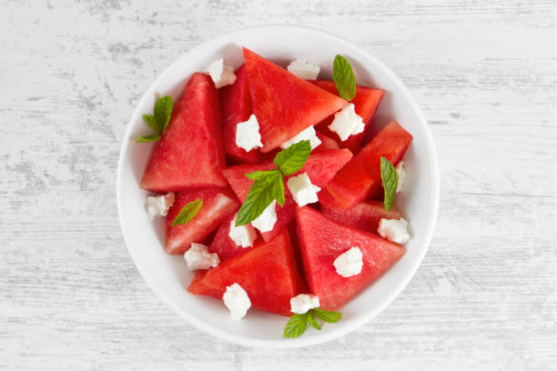 Fresh Watermelon Salad Fresh watermelon salad with feta cheese from above. feta cheese stock pictures, royalty-free photos & images