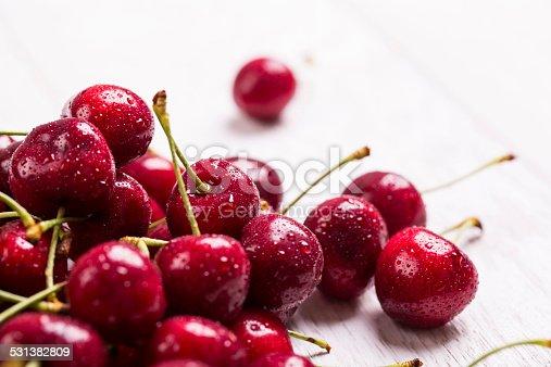 fresh cherry on white wooden table