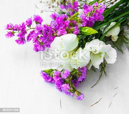 867916232 istock photo Fresh white and purple flower bouquet, spring fresh flowers 653081356