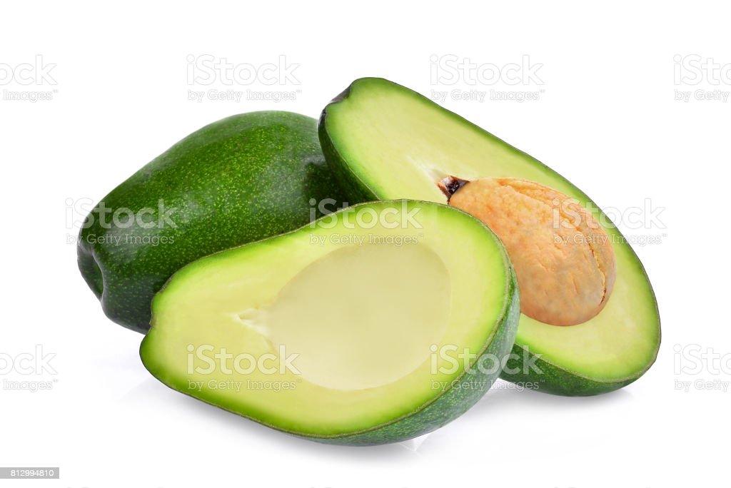 fresh whole and half avocado isolated on white background stock photo