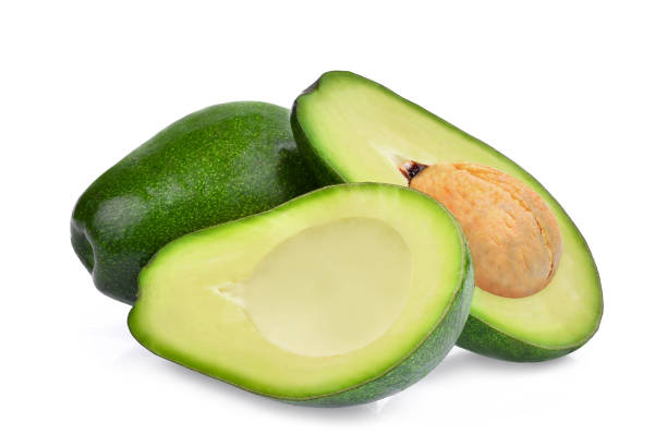 fresh whole and half avocado isolated on white background – zdjęcie