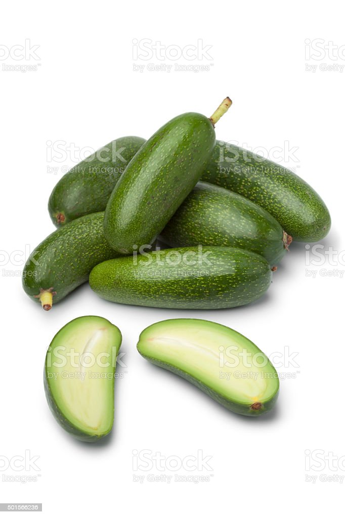 Fresh whole and half cocktail avocado's stock photo