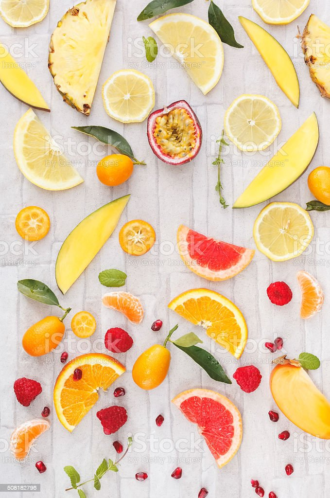 Fresh whole and sliced yellow, orange and red fruits stock photo