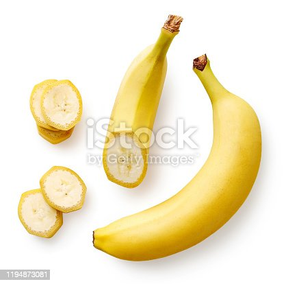 Fresh whole, half and sliced banana isolated on white background, top view