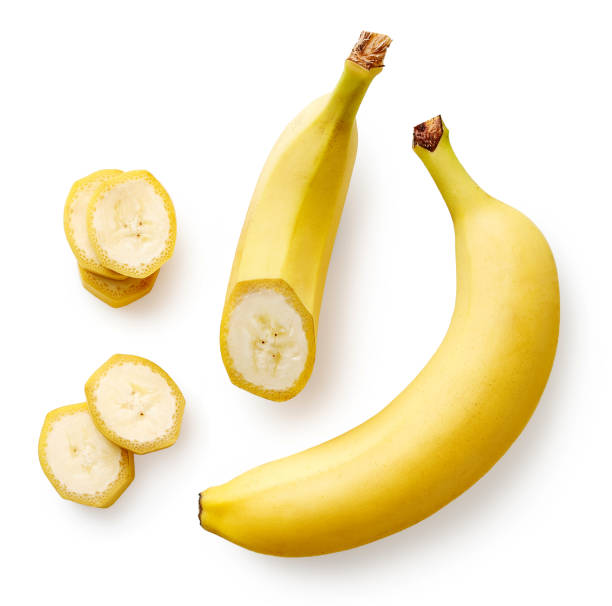 Fresh whole, half and sliced banana Fresh whole, half and sliced banana isolated on white background, top view banana stock pictures, royalty-free photos & images