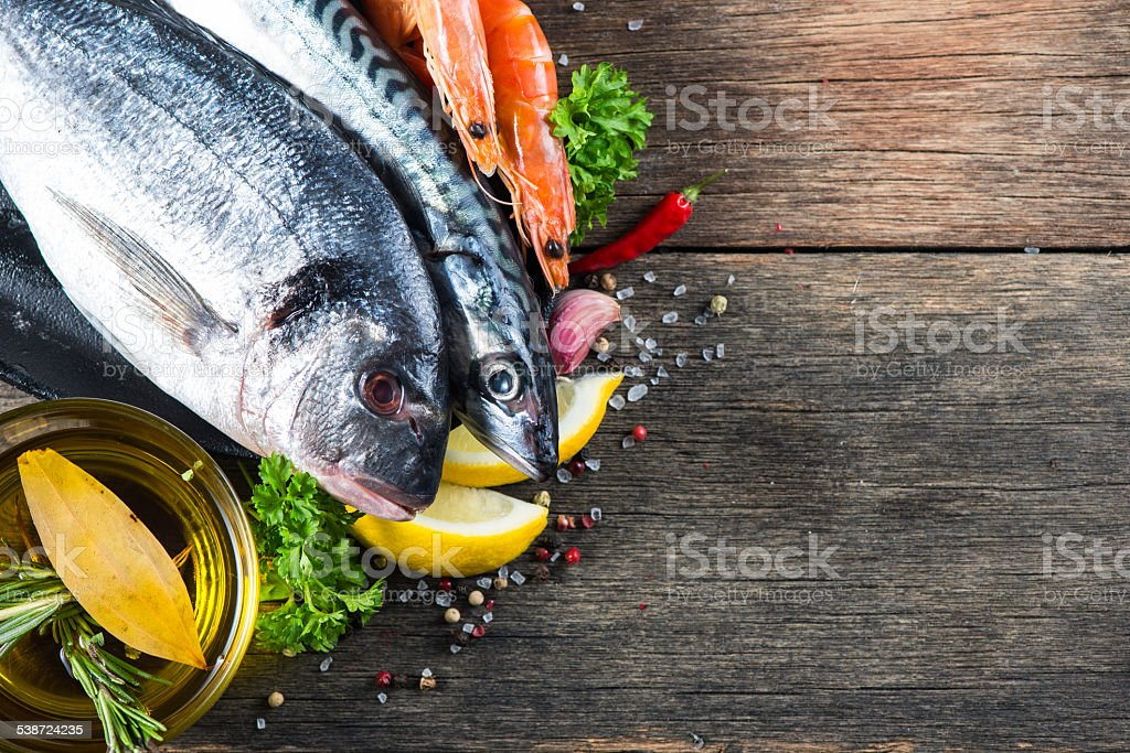 Fresh whole sea fish with aromatic herbs and spices stock photo