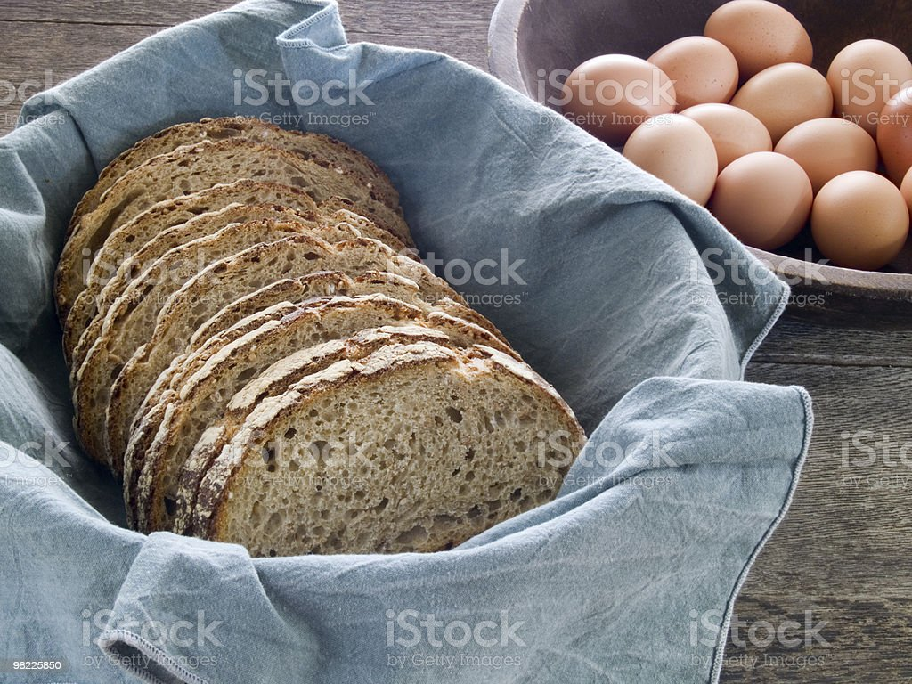 Fresh whole wheat bread and eggs royalty-free stock photo