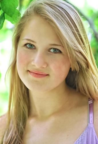 Fresh Wholesome Teenage Girl Portrait Blonde Hair Blue