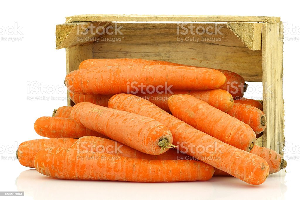 fresh winter carrots coming from  a wooden box royalty-free stock photo