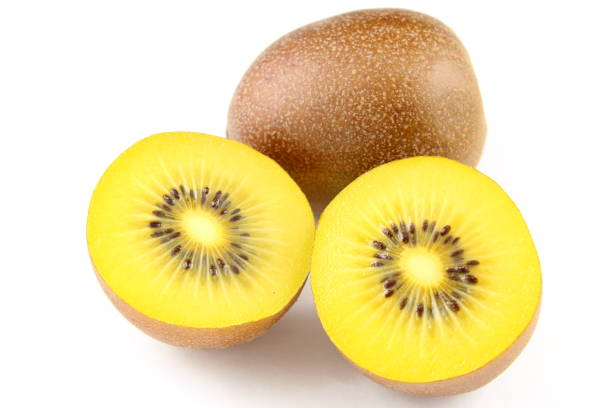 frutas frescas kiwi amarelo isoladas em um fundo branco - foto de acervo