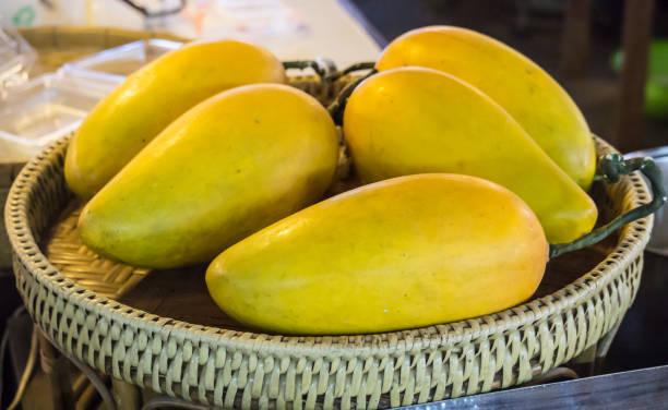 Fresh Yellow Mango Fruit in Handcraft Basket Fresh Market Concept stock photo