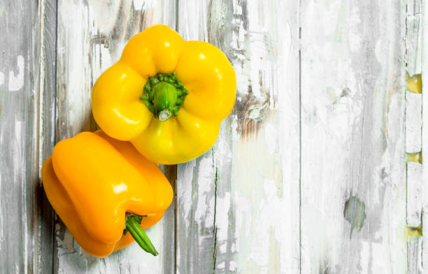 Fresh yellow pepper. Fresh yellow pepper. On white wooden background yellow bell pepper stock pictures, royalty-free photos & images