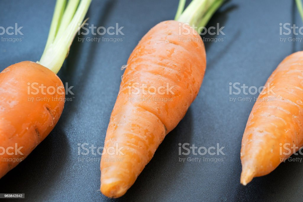 Fresh young carrot on a black background - Royalty-free Agriculture Stock Photo