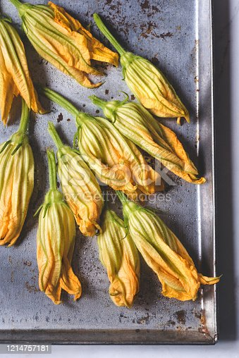 Fresh zucchini flowers (Fiori di zucca) with  drops of water, close-up, selective focus. Interesting South Italian Cuisine Ingredients